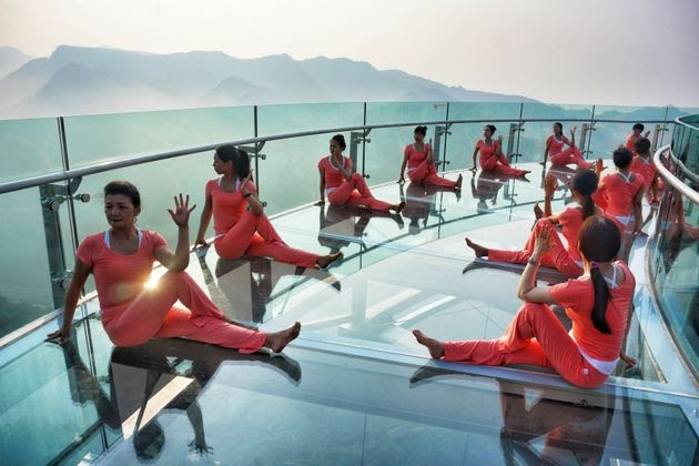 A group of yoga enthusiasts practice yoga in Beijing, China. The presentation takes place on the world's largest gl