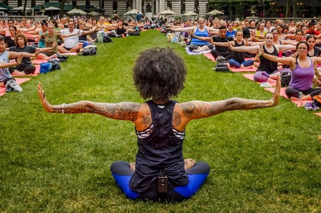 People practice yoga in Bryant Park in New York.