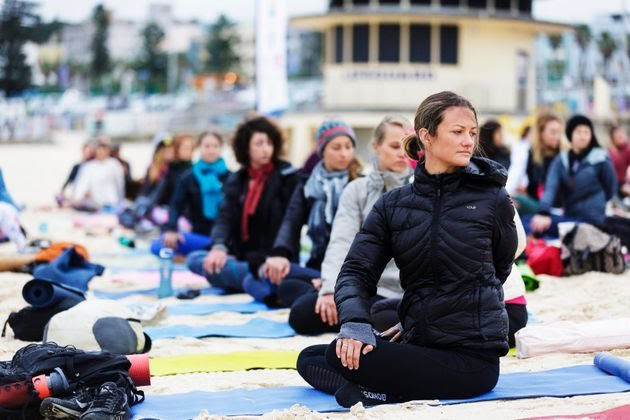 People participate in a yoga class at Bondi Beach in Sydney, Australia.