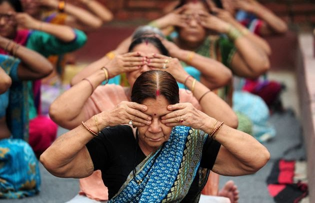 Indians yoga practitioners take part in a workshop at a temple on the banks of the River Ganges in Allahabad, India.