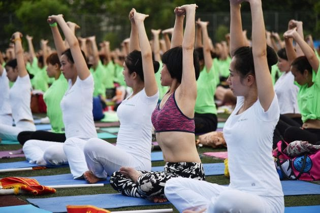 Thousands of people do yoga at Futian Sports Park in Shenzhen, China.