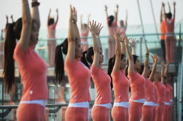 Yoga enthusiasts practice poses at Shilin Gorge in Beijing, China.