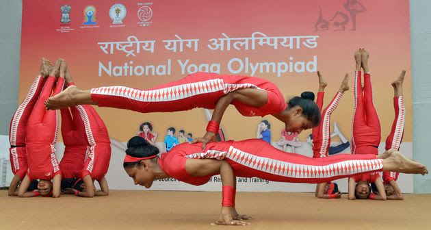 Students perform yoga during the National Yoga Olympiad in New Delhi, India.