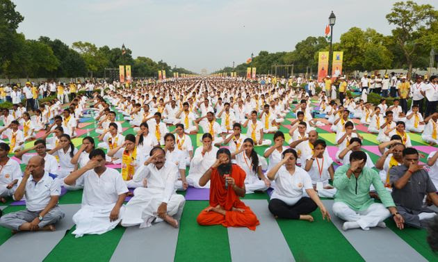 Yoga exponent Ramdev and Union Minister Venkaiah Naidu practice yoga along with others during a yoga camp in New Delhi, India