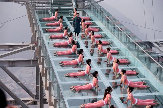 People practice yoga at a tourist spot on the outskirts of Beijing, China.