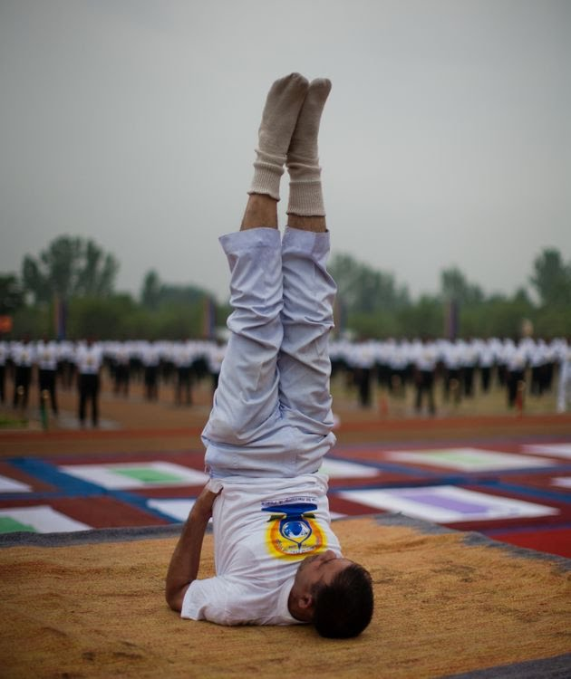 Indian Paramilitary soldiers of Central Reserve Police Force (CRPF) perform Yoga exercise in their camp in Kashmir, India.